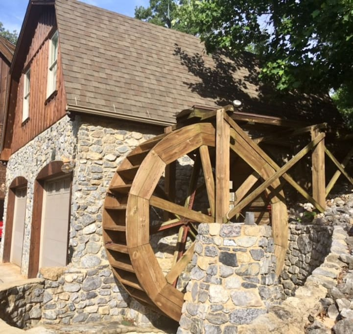 Unique water wheel on guest house