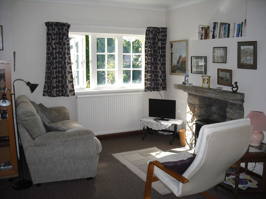 Comfortable sitting area with DVD/TV, free Wifi and views over the garden