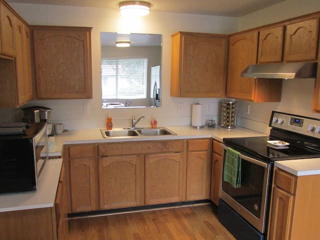 A light and airy kitchen with dishes, pots and pans, a variety of 20 spices is there to serve you.