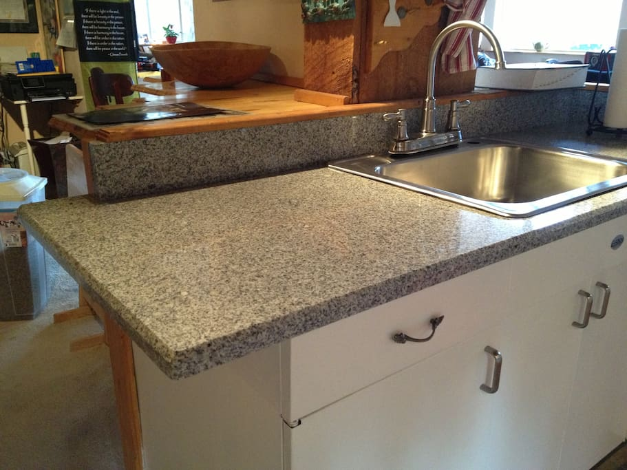 New meets old! Granite countertops on a 1950's steel sink cabinet.