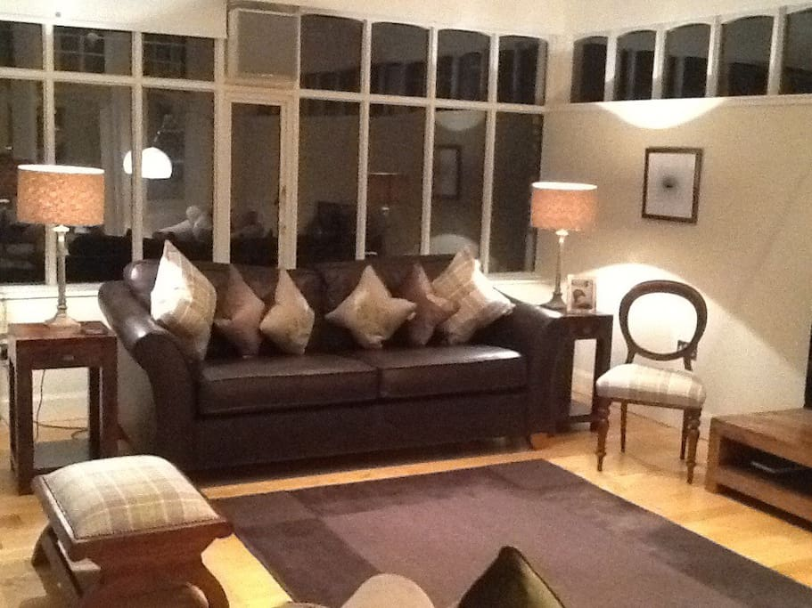 Spacious  comfortable living room with direct access to private garden.