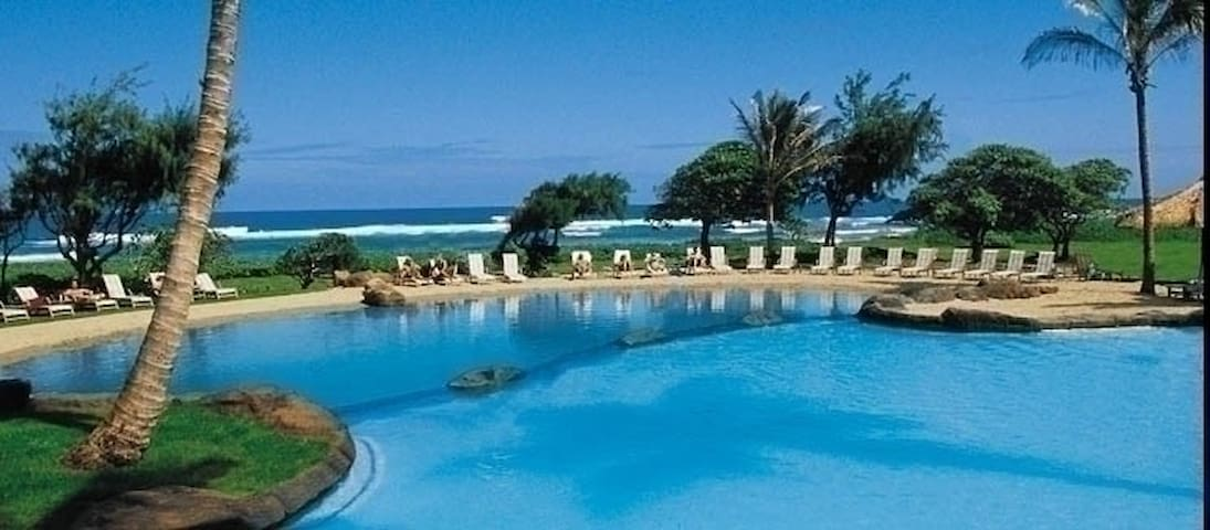 Beautiful shallow pool with water slide right on the beach.