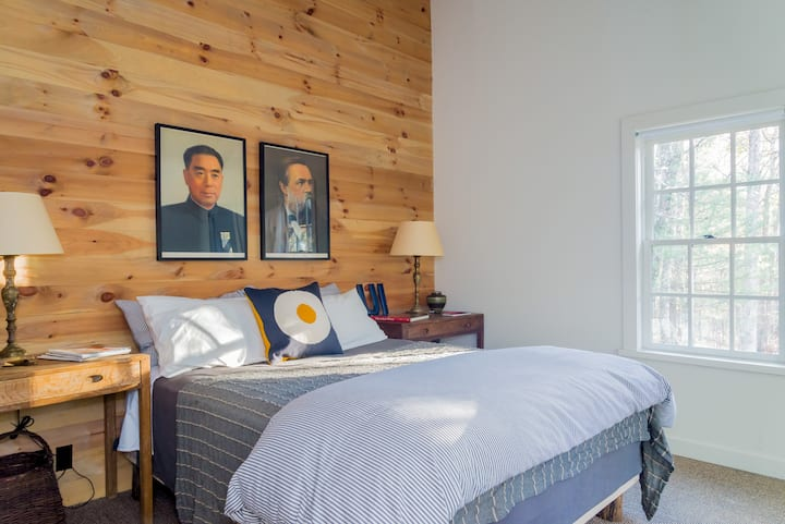 Bedroom #1 -- high pitched ceiling, warm wood, brand new queen size bed, TV sitting area, A/C unit, private shower & bath