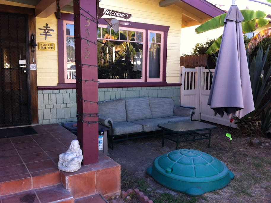 The front yard has a playground for kids and a sitting area