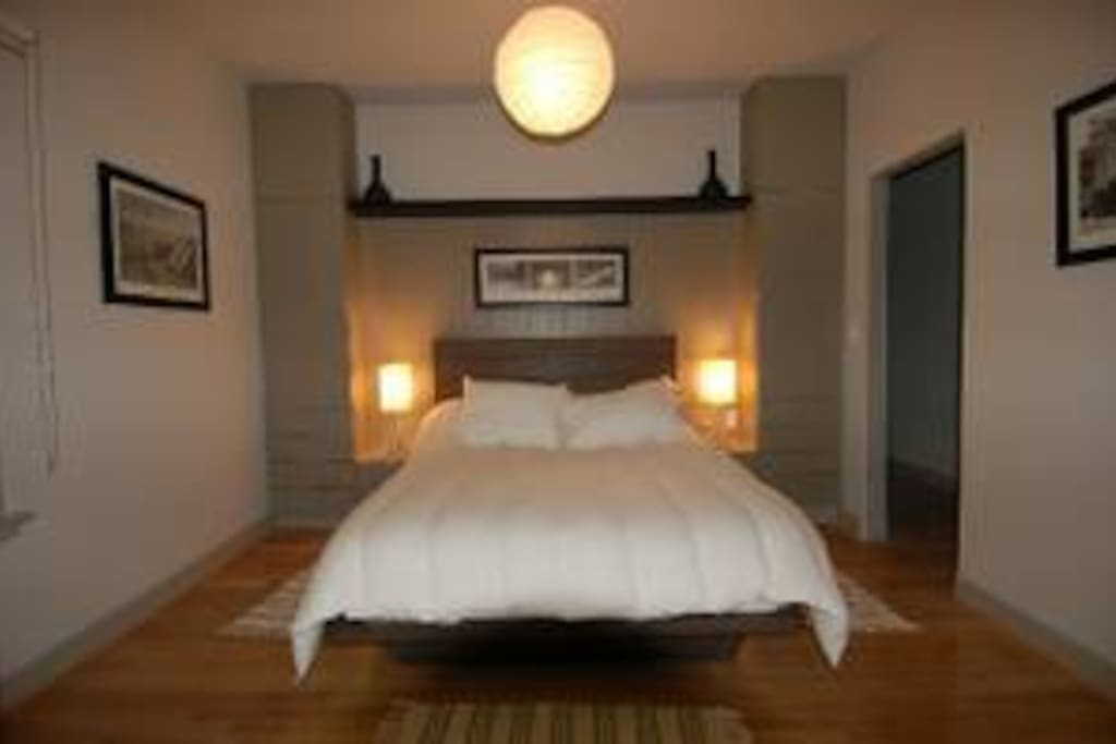 Inside our Queen Suite w/ ocean views. Just one of the comfortable king-sized beds we have to offer at Su Casa!