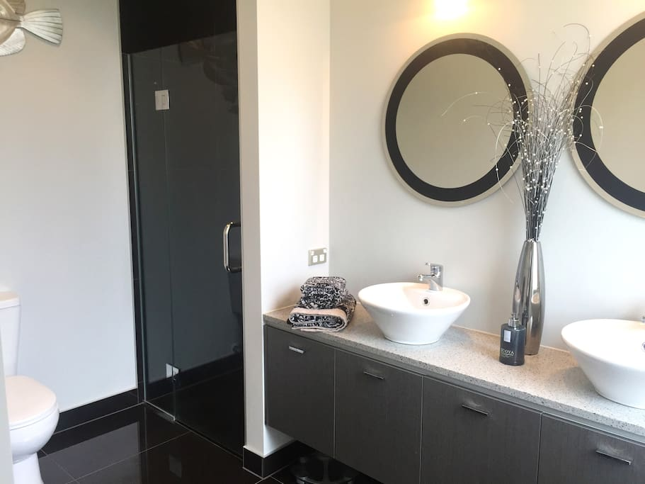 Master bedroom ensuite with double basin, tiled shower and toilet