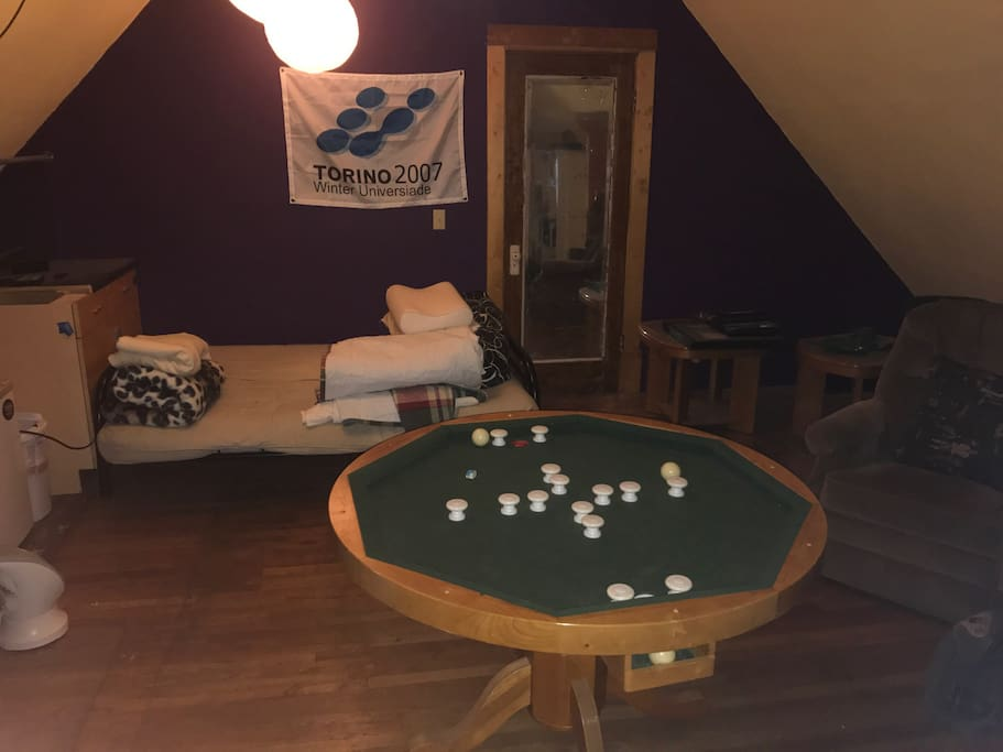 Game room including pool table and foosball.