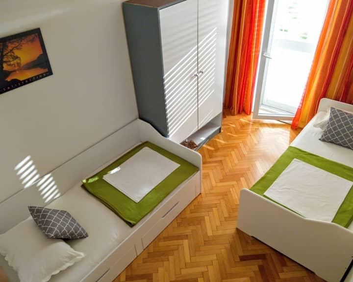 Private studio with balcony in center