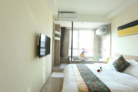 青旅遇尚私汤温泉公寓酒店——河景大床房