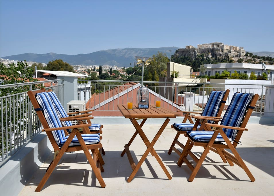 Relax and enjoy your drink with the astonished view of Acropolis