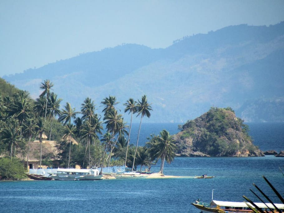 Camera zoom of Puerto Galera Bay. This private beach is an awesome place to picnic on a day of island hopping.