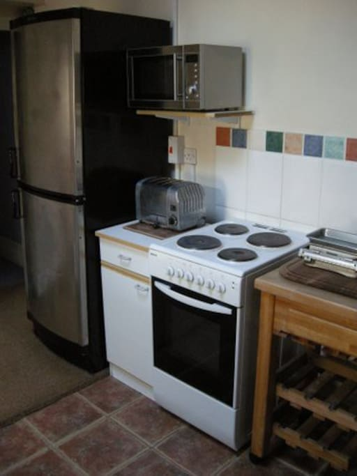Kitchen is fully equipped with oven, fridge freezer, microwave and washing machine.