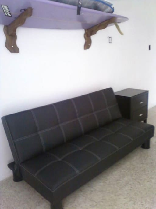 Futon for 2 extra guests, great for kids! In living room with a/c
