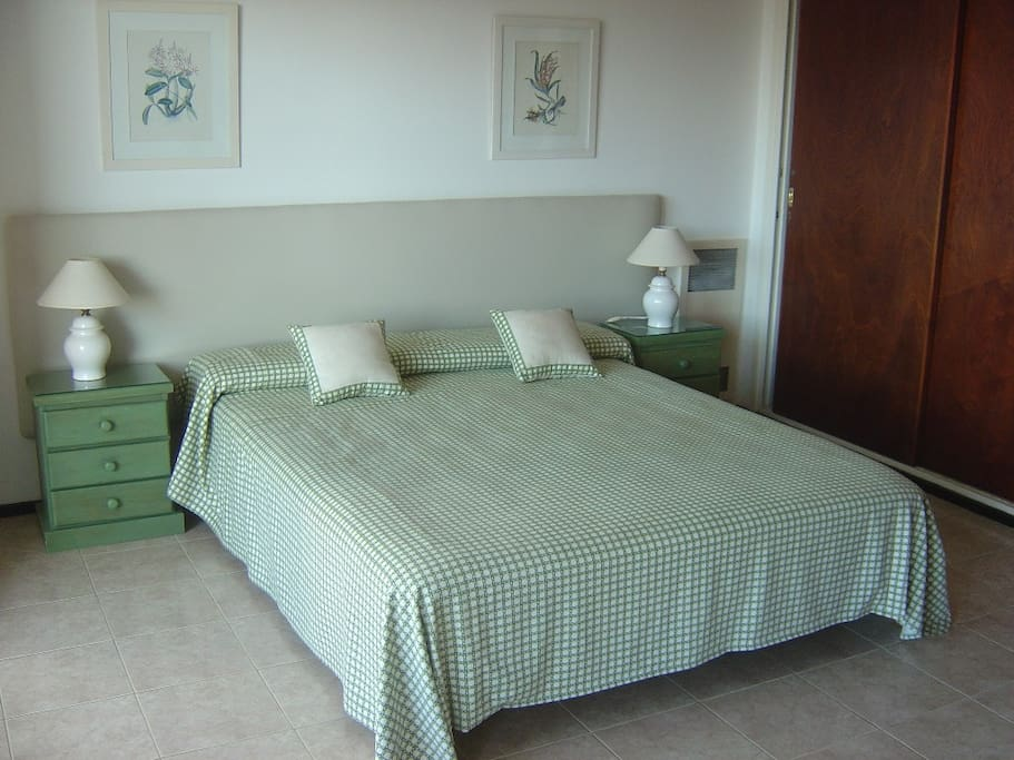 Bedroom with queen size bed and spacious wardrobe