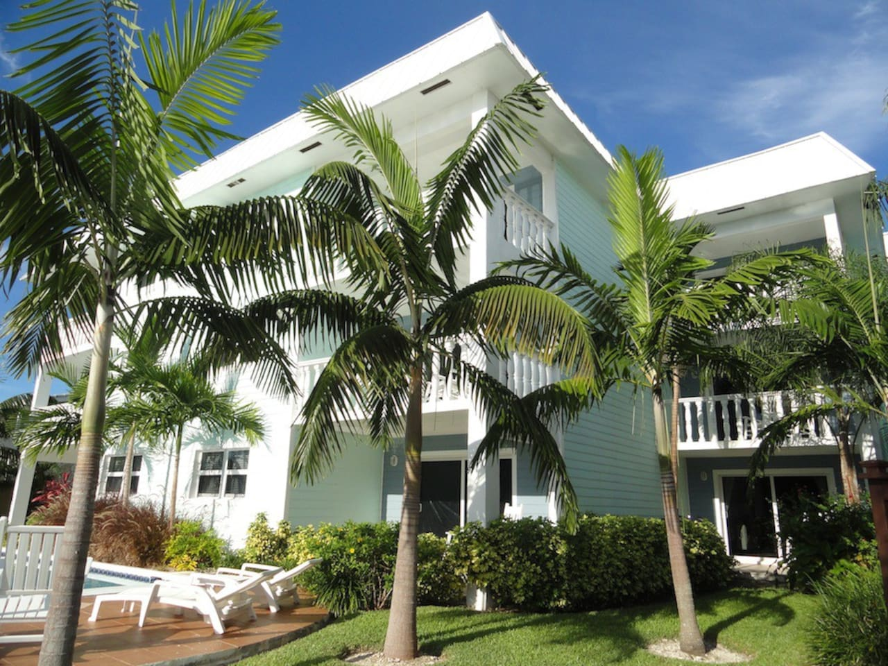 Beautiful Bahamian Style Building with lush landscaping