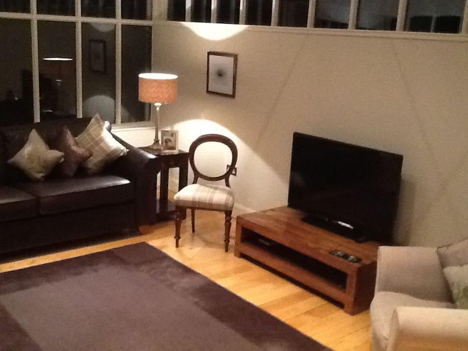 Comfortable livingroom furnished to a high standard.