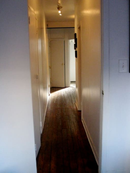 Apt is a railroad apt, this is a picture of the hallway and the kitchen is at the far end.