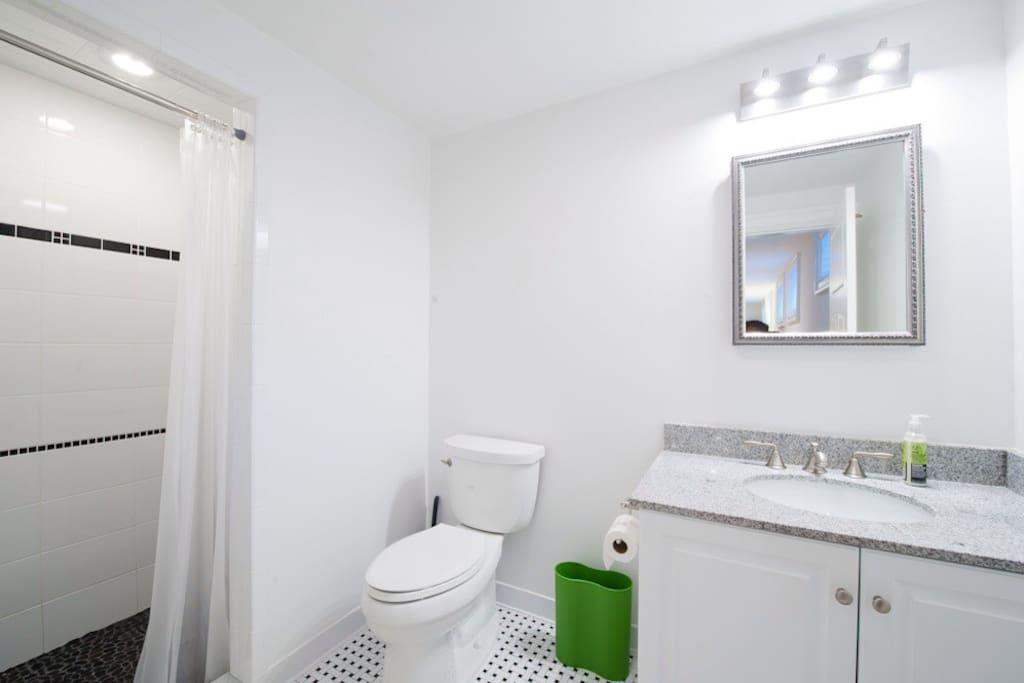 Clean and simple. Blow dryer below sink if needed.