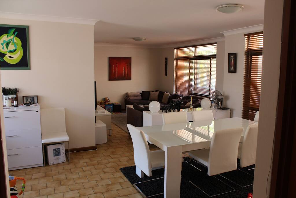 View from front entrance into Dining and Living Space - long balcony to the side with table and BBQ