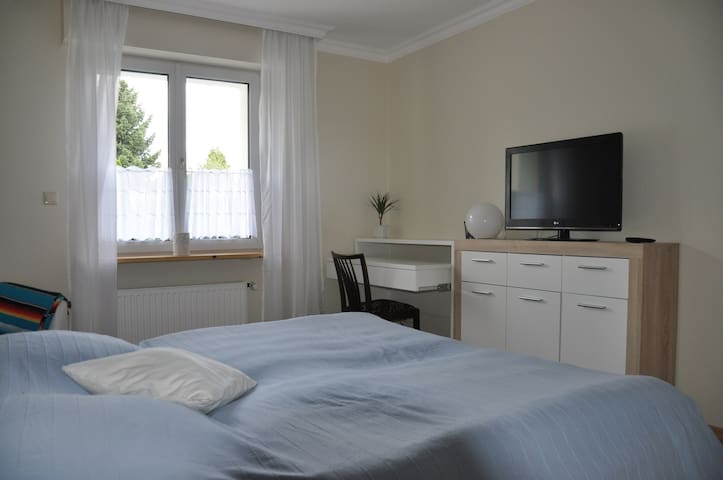 Sleeping Room with double bed, chair, workplace & SAT-TV