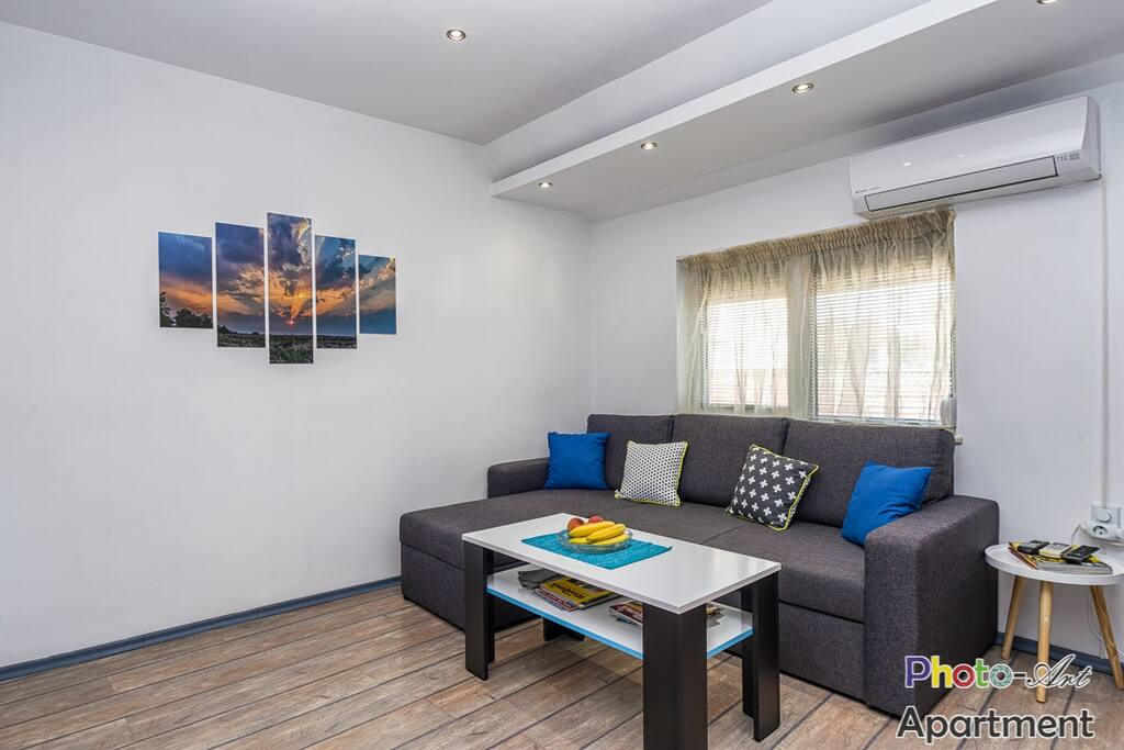 Photo-art apartment Comfortable sofa bed and coffee table