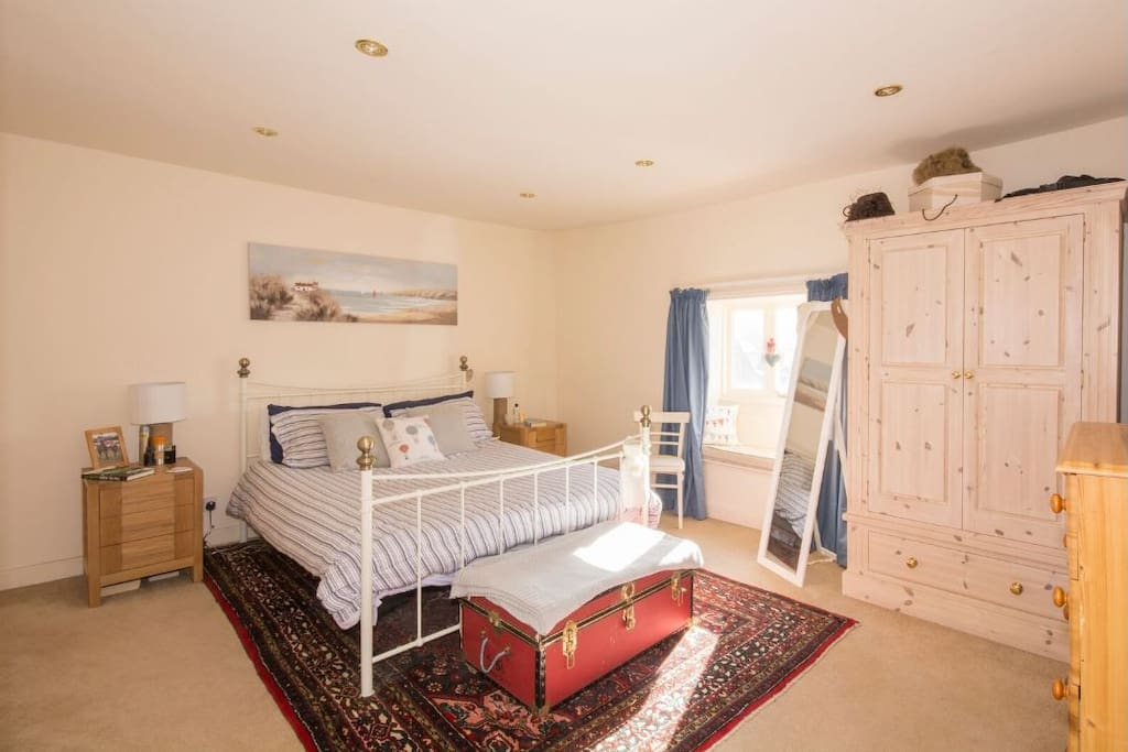 Large bedroom with king size bed and plenty of storage