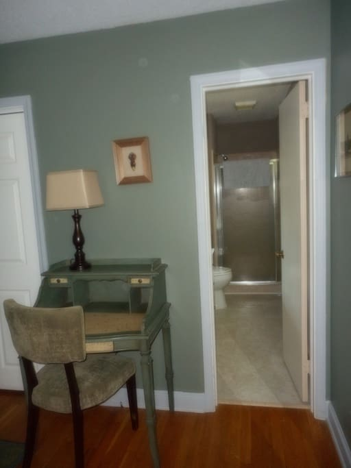 Writing desk and doorway into en suite private bathroom