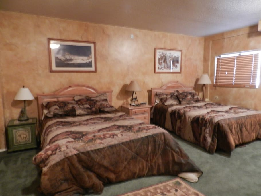 Large bedroom with 2 queens, also has own bathroom,