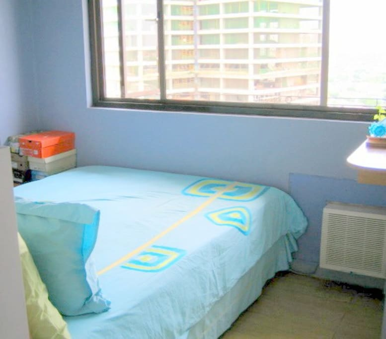 Air Conditioned Bedroom with linens.