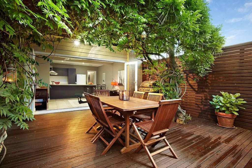 Back deck with wisteria and a barbeque