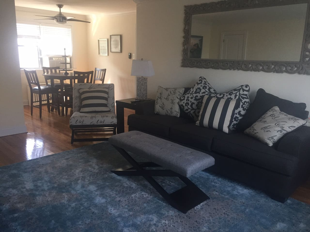 living room with sofa bed leading into dining area.