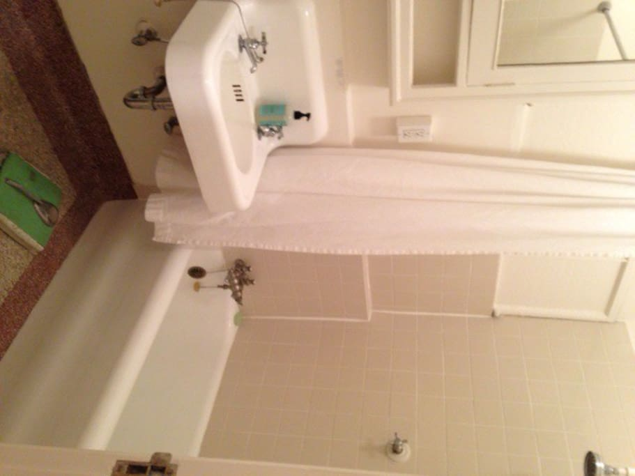 Small but spotless bathroom. Great for the person who likes to know these amenities are always being disinfected