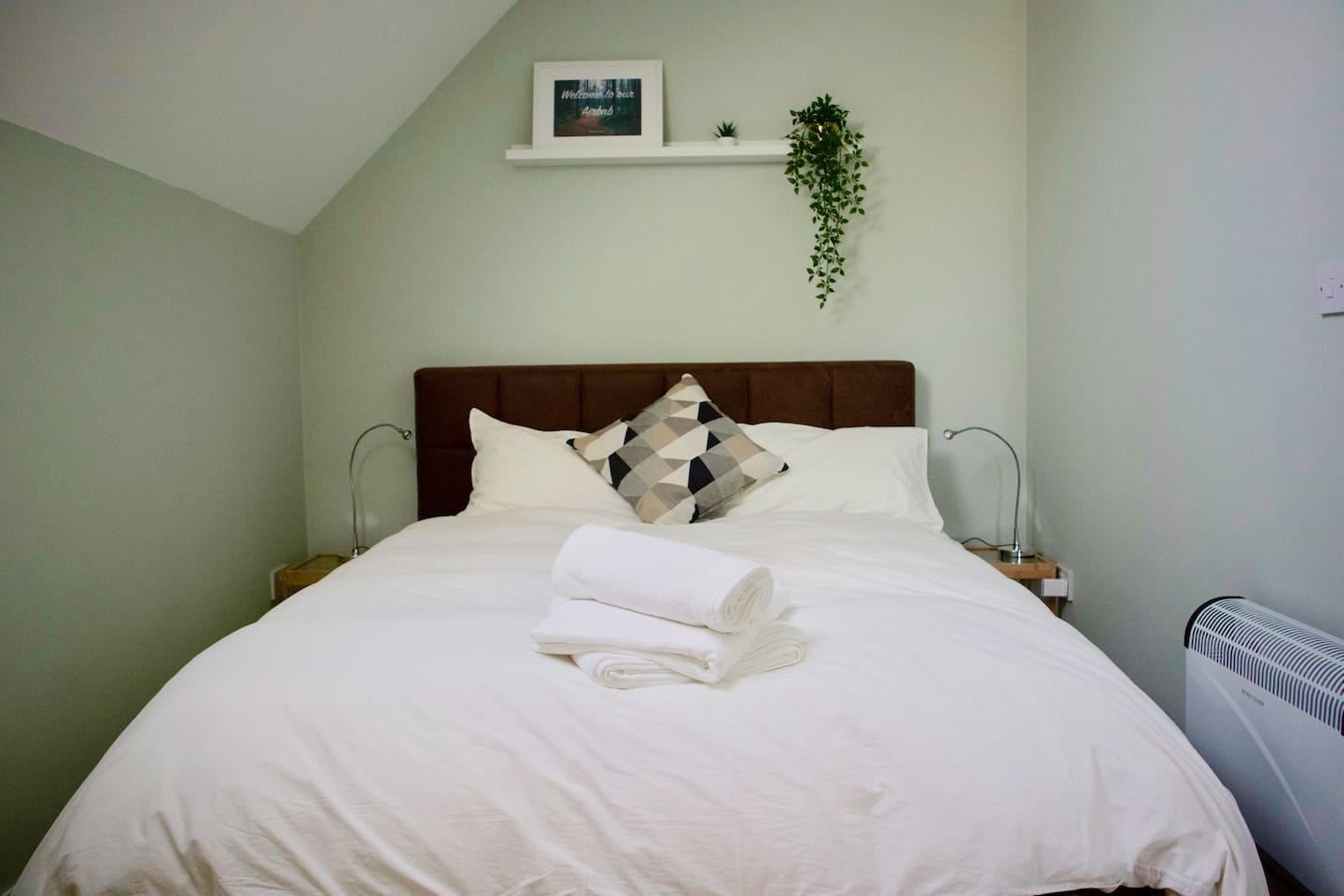 Bright clean space with orthopaedic king size bed.