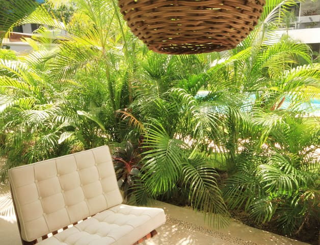 Imagine reading a book on this comfortable sofa while hearing the peaceful sound made by the vegetation surrounding you.