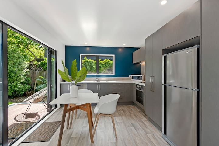 Modern Merivale Village apartment with Garden.