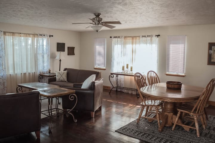 From the cozy furnishings to earthy browns and creamy whites color palette, our cozy Black Hills cottage is filled with relaxed character alongside hints of modern style.