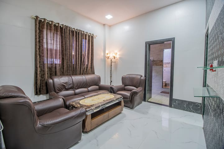 Airy Living Area/Hall with 5 seater sofa.