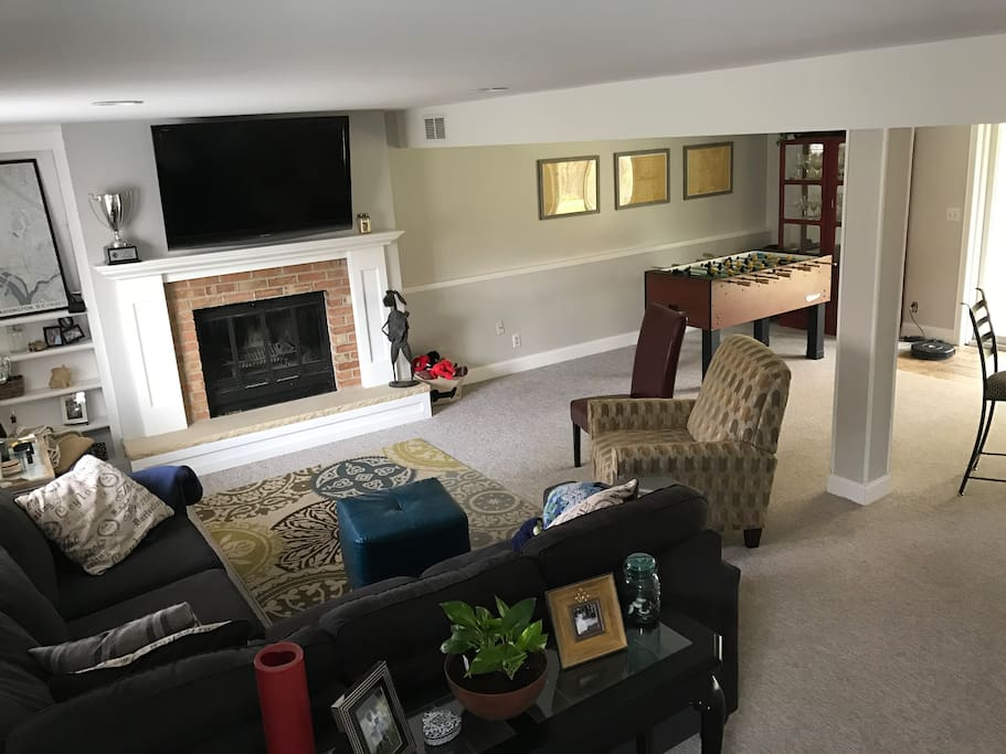 Family room with great entertainment potential, with big screen TV and plenty of sitting room.