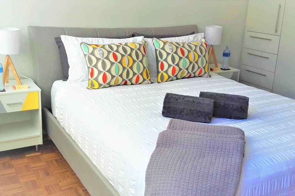 Bedroom with queen size bed and built in cupboard space