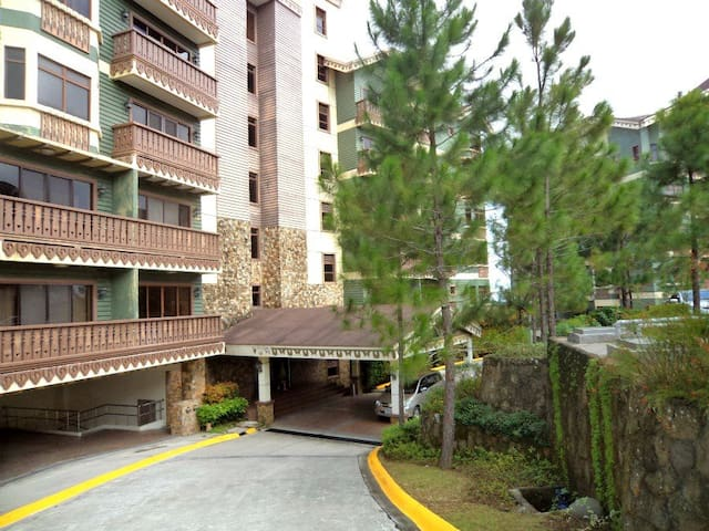 Facade of the condo. With ample parking space