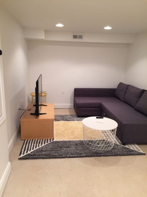 Your own living room with couch that converts to double bed