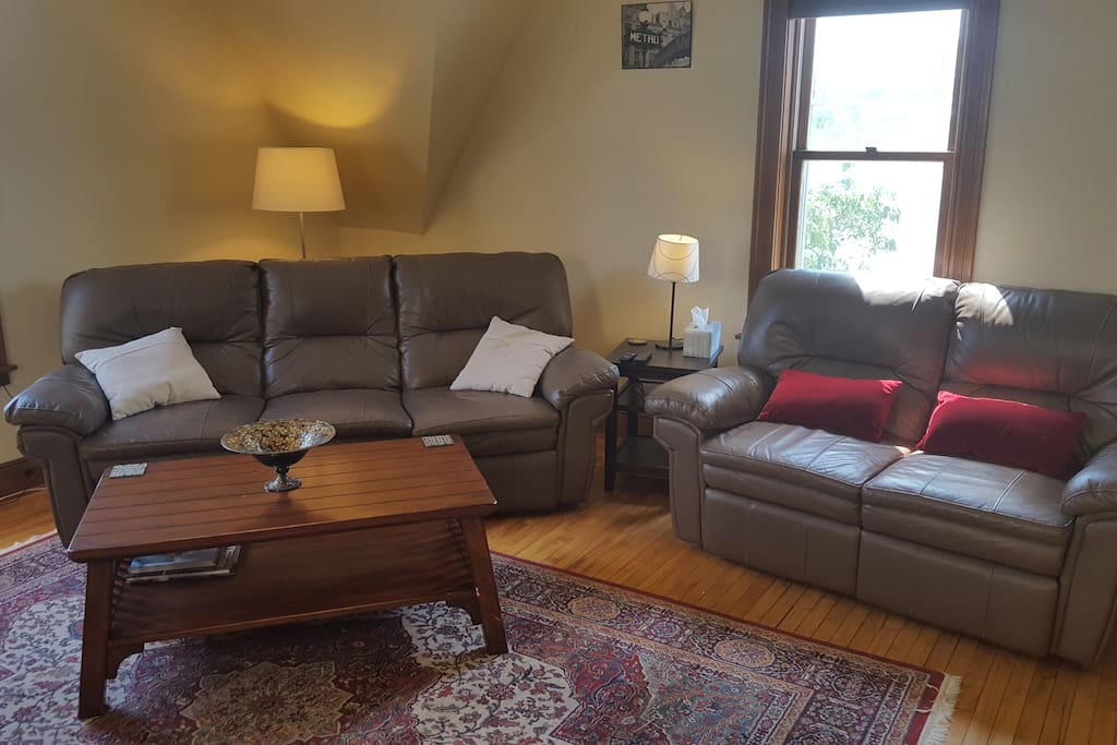 Living Room with 2 couches, each with two reclining sections
