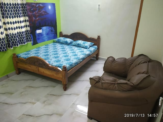 Master bedroom 1 with 1.5 ton AC and sofa along with attached bathroom..
