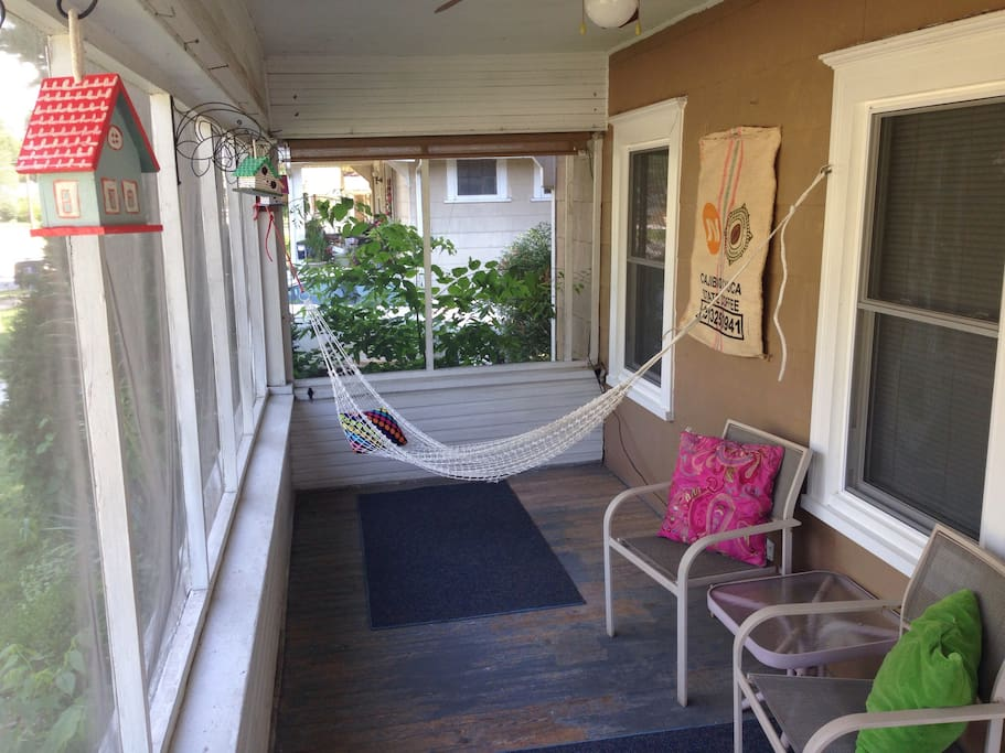 A hammock and chairs in the screened in porch make for bug-free r and r.