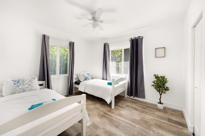 The South Bedroom Is Fitted With Two Twin Beds and A Built-In Wardrobe Closet. All Bedrooms Come With Blackout Curtains To Make Sure You Get A Full Night's Sleep In The Blistering Miami Sun.