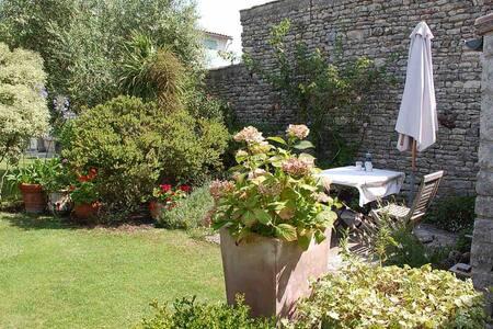 Maisonnette avec jardin partagé