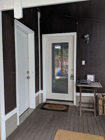 The cozy loft is waiting for you just through the glass door. Please note your key also accesses the garage door to the left, where full laundry facilities are provided.