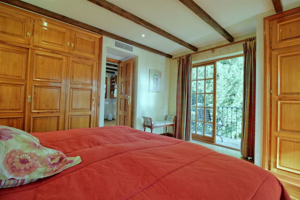 Master bedroom with attached bathroom, wardropes, dressing table and two balconies