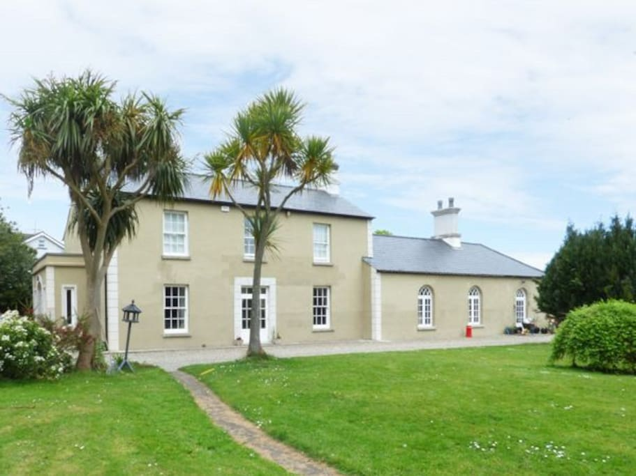 Apartment is in the rear courtyard of this house surrounded by 2.5 acres of parkland
