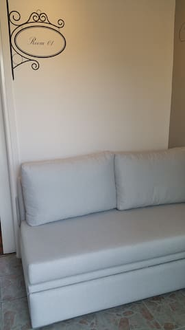 Couch in hall that turns to a bed